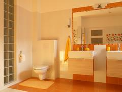 orange optimistic bathroom. - stock photo