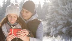 Christmas Surprise Present Young Couple Outdoors Stock Footage