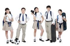 Happy schoolchildren and their leisure interests - stock photo