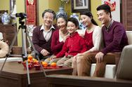Stock Photo of Family taking home video during Chinese New Year