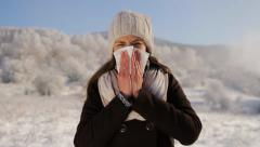 Woman with Flu Blowing Nose Outdoors Winter - stock footage