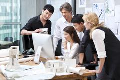 Architects working in studio Stock Photos