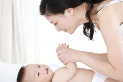 Maternal love never changes - stock photo