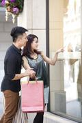 Fashionable young couple go window shopping in Hong Kong - stock photo