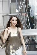 Fashionable young woman shopping in Hong Kong - stock photo
