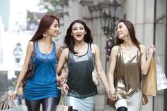 Cheerful best female friends go shopping in Hong Kong Stock Photos