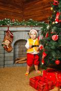 Baby christmas gifts and christmas tree Stock Photos