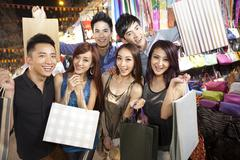 Happy young people shopping on Temple Street of Hong Kong, night view Stock Photos