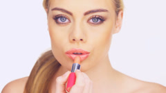 Woman lipstick kiss Stock Footage