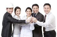 Stock Photo of Confident workers in different occupations shaking hands