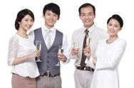 Stock Photo of Wealthy family having champagne