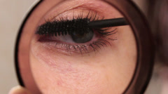 Woman paints eyelashes 2 Stock Footage