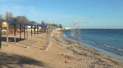 People walk on the beach in Yevpatoria - stock footage