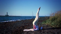 Woman doing yoga poses on a calm Icelandic beach 5 - stock footage