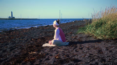Woman doing yoga poses on a calm Icelandic beach 6 - stock footage