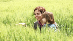 Mother and daughter in a wheat field Stock Footage