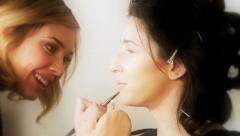 Backstage of fashion model getting touched up Stock Footage