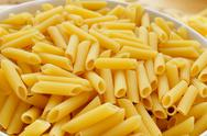 Stock Photo of uncooked penne rigate