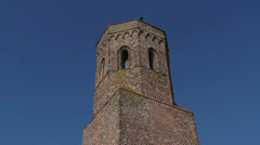 Koudekerke, The Netherlands: Medieval tower Plompe Toren, tilt down Stock Footage