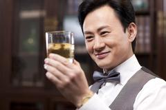 Businessman appreciating fine wine - stock photo