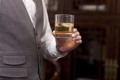 Businessman with a glass of wine Stock Photos