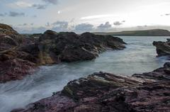 Cornish dusk seascape, Polzeath, United Kingdom - stock photo