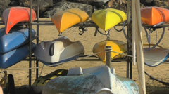 Sporting Club Canoes on the beach Stock Footage
