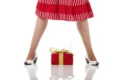 woman legs with a gift - stock photo
