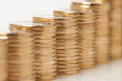 Stock Photo of Growing amount of coins