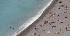 Ultra HD 4K Aerial View Nice French Riviera Tourist Sunbathing Swimming Sunny Stock Footage