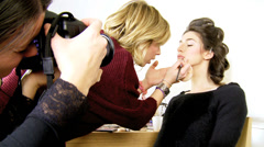 Fashion model being photographed during makeup Stock Footage