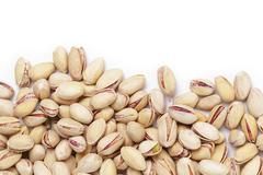 Border from roasted salty pistachios nuts Stock Photos