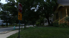 Driving through suburban/urban neighborhood 5 - stock footage