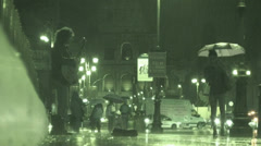 Man busking in heavy rain, Colosseum (Infrared Night Vision) Stock Footage