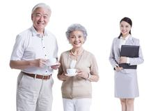 Senior couple with financial advisor - stock photo