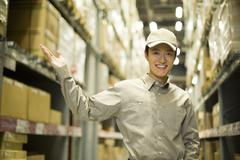 Young logistics staff in warehouse Stock Photos