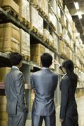 Business people talking in warehouse - stock photo