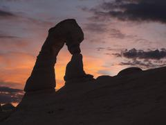 Delicate arch sunset at arches national park Stock Photos
