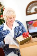 Christmas: woman ready to ship holiday gifts Stock Photos