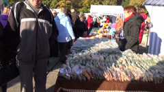 Dried seeds herbs in plastic bags placed rows of market stalls Stock Footage