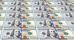 Several of the newly designed u.s. one hundred dollar bills. money concept. Stock Photos