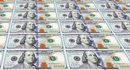 Stock Photo of several of the newly designed u.s. one hundred dollar bills. money concept.