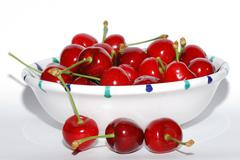 Many cherries  in a bowl Stock Photos