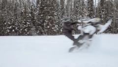 Extreme Snowmobiler does a wheelie Stock Footage