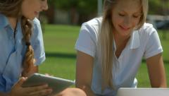 Two High School Girls Use A Tablet And Laptop Stock Footage