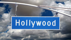 Hollywood Bl Street Sign with Moving Clouds Stock Footage
