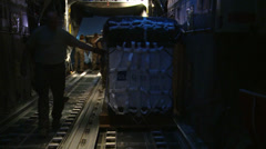 Loading a C-130H Hercules ready for Airdrop Over Afghanistan at Night Stock Footage
