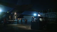 Stock Video Footage of Loading a C-130H Hercules ready for Airdrop Over Afghanistan at Night