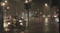 Heavy rain, traffic and umbrellas# Stock Footage