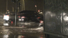 Speeding cars in wet conditions# Stock Footage